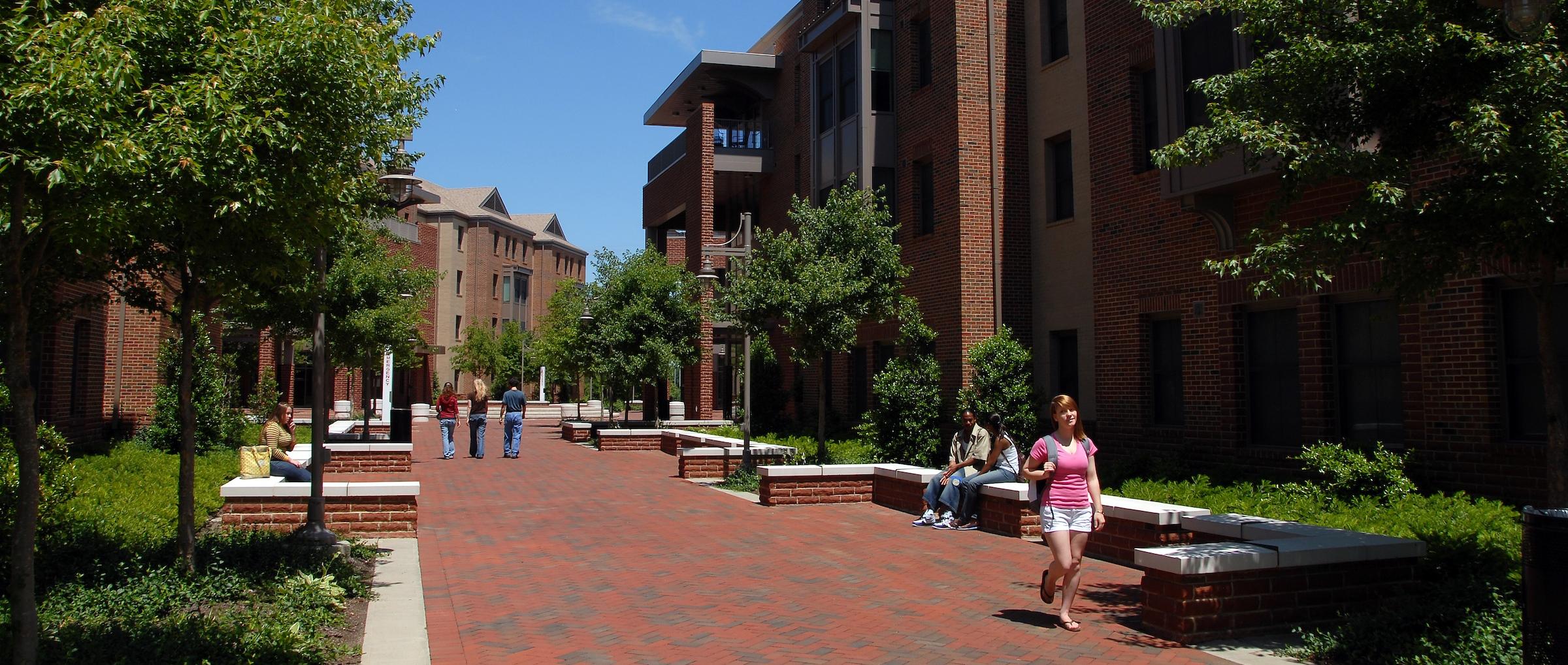 Students walk through Wolf Village Courtyard