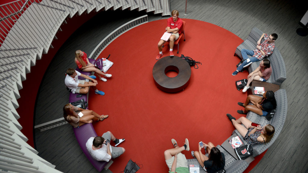 Students have a discussion sitting in a circle.