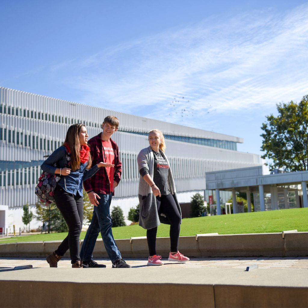 Students walk through Centennial Campus on a beautiful day