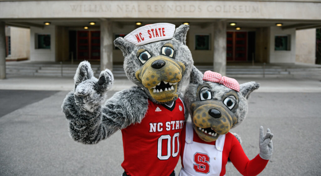 Mr. and Mrs. Wuf show their school spirit on main campus. Photo by Marc Hall